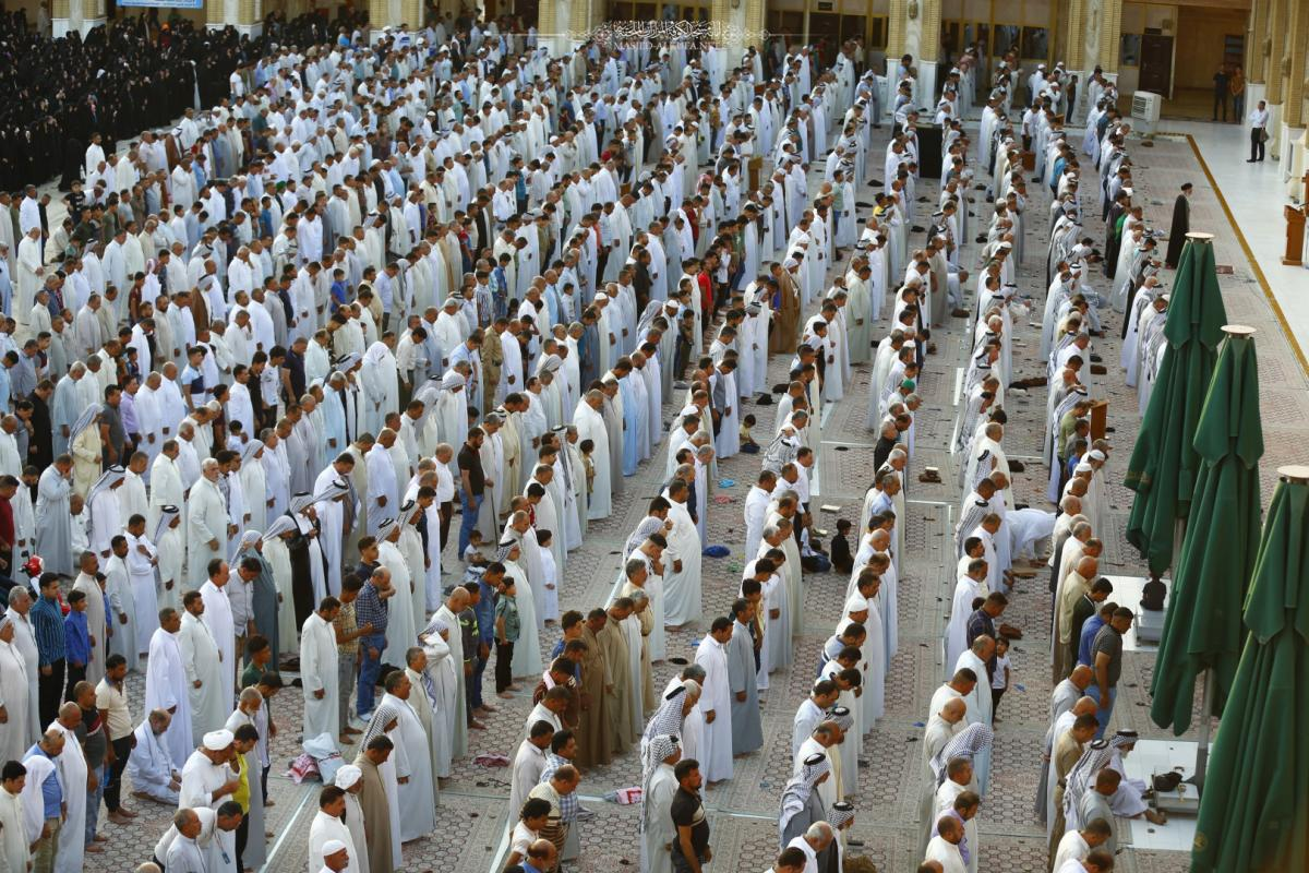 Holding Eid Prayer at Alkufa Grand Mosque preached by His Eminence Sayed. Hussein Anori