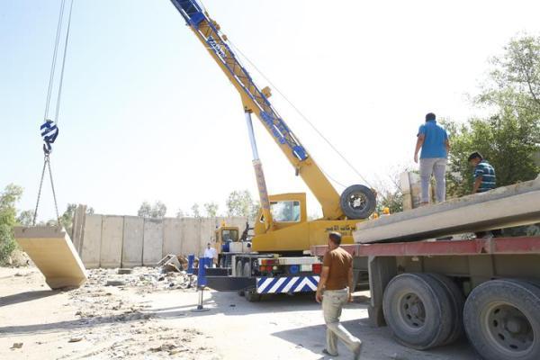 تعاون الكوادر الهندسية في أمانة مسجد الكوفة المعظم  مع فوج الطوارئ الثاني