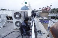 شعبة الالكترونيك في أمانة مسجد الكوفة تمد الكابلات الضوئية لتنصيب الكاميرات في دار أمير المؤمنين( ع)